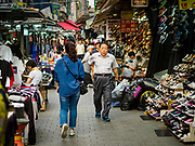 08 JUNE 2018 - SEOUL, SOUTH KOREA: People walk through Namdaemun Market. Namdaemun Market is one of the oldest continually running markets in South Korea, and one of the largest retail markets in Seoul.[6] The streets in which the market is located were built in a time when cars were not prevalent, so the market itself is not accessible by car. The main methods of transporting goods into and out of the market are by motorcycle and hand-drawn carts. It occupies many city blocks, which are blocked off from most car traffic due to the prevalence of parking congestion in the area.     PHOTO BY JACK KURTZ