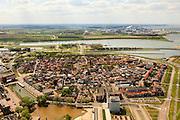 Nederland, Zeeland, Terneuzen, 09-05-2013; Zeeuws-Vlaanderen, centrum van Terneuzen gezien naar Kanaal Terneuzen - Gent. Chemische fabriek Dow Benelux (Dow Chemical Terneuzen) op de andere oever rechtsboven in beeld. <br /> View on the center Terneuzen (Zeeland) and the entrance to the  Terneuzen - Ghent Canal. View on chemical factories Dow Benelux (Dow Chemical Terneuzen) top right. luchtfoto (toeslag op standard tarieven);<br /> aerial photo (additional fee required);<br /> copyright foto/photo Siebe Swart.