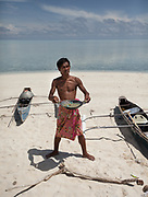 """Dido with cooked coral fish called """"Ogus"""". On Mantabuan island."""