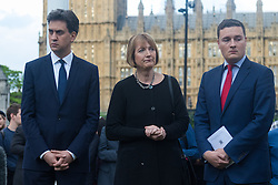 Parliament Square, Westminster, London, June 17th 2016. Following the murder of Jo Cox MP a vigil is held as friends and members of the public lay flowers, light candles and leave notes of condolence and love in Parliament Square, opposite the House of Commons. PICTURED: Ed Miliband, Harriet Harman and Wes Streeting lead. the vigil