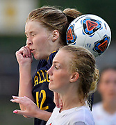 OFallon midfielder Calissa Strohbeen (left) and Edwardsville forward Payton Federmann leap for a header. OFallon defeated Edwardsville in a girls soccer playoff game at OFallon High School in OFallon, IL on Tuesday June 8, 2021. <br /> Tim Vizer/Special to STLhighschoolsports.com.