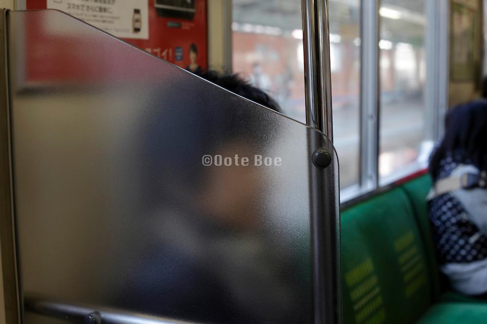 commuters in a train Tokyo Japan