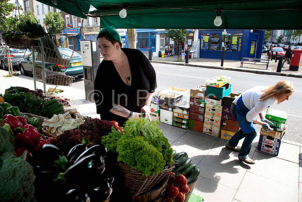 LONDON, ENGLAND, UK, JUNE 18TH 2011. Mother Louise Irwin-Ryan at a deli and fresh food shop in her neighbourhood of Barnsbury, near to Kings Cross, North London. Louise is on various benefits to help support her family income, and housing, although recent government changed to benefits may affect her family drastically, possibly meaning they may have to move out of London. Louise Ryan was born on the Wirral peninsula in 1970.  She moved to London with her family in 1980.  Having lived in both Manchester and Ireland, she now lives permanently in North London with her husband and two children. Through the years Louise has battled to recover from a serious motorcycle accident in 1992 and has recently been diagnosed with Bipolar Affective Disorder. (Photo by Mike Kemp/For The Washington Post)