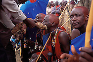 New Kenyan Masia elders (right) are fed the meat of a freshly slaughtered cow to celebrate their elevation to elder, during their participation in the three day festival of Masai warriors in Kajiado, Kenya on Saturday, November 10, 2001. The traditional Masai Manyatta festival brings Kenyan men and women together to celebrate the younger Masai warriors reaching the next age level to become junior elders.