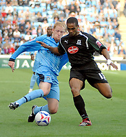 Photo: Ed Godden.<br />Coventry City v Plymouth Argyle. Coca Cola Championship. 30/09/2006. Coventry's Andrew Whing (L) is tackled by Mathias Doumbe.