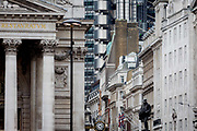 The statue of civil engineer James Henry Greathead 1844 – 1896, renowned for his work on the London Underground railway stands beneath the tall buildings at Cornhill in the City of London, the capitals financial district aka The Square Mile, on 26th March, 2018, in London, England.