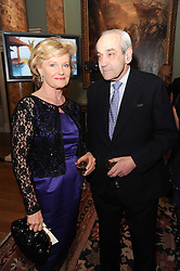 A party to promote the exclusive Puntacana Resort & Club - the Caribbean's Premier Golf & Beach Resort Destination, was held at Spencer House, London on 13th May 2010.<br /> <br /> Picture shows:-MR & MRS PERRETT