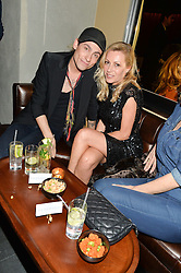 KYLE DE'VOLLE and MANDY THORNTON at the launch of hidden bar 'Blind Spot' at St.Martin's Lane Hotel, St.Martin's Lane, London on 6th May 2015.