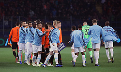 October 23, 2018 - Kharkiv, Ukraine - Players of FC Shakhtar Donetsk (orange and black kit) and Manchester City FC (blue kit) shake hands on the pitch before the UEFA Champions League Group F Matchday 3 game at the Metalist Stadium Regional Sports Complex, Kharkiv, northeastern Ukraine, October 23, 2018. Ukrinform. (Credit Image: © Danil Shamkin/Ukrinform via ZUMA Wire)
