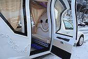 Pimp my PT Cruiser: The Russian women getting modern-day Cinderella treatment in customized Chrysler rides<br /> <br /> From stretch limousines to flower-adorned carriages, brides-to-be usually arrive at their big day in a grand, elegant fashion.<br /> But now, Russian women have been given the chance to make a more unusual entrance - by riding in a pimped-out PT Cruiser.<br /> Photos show a number of the vehicles - first launched by car manufacturer Chrysler in 2000 - transformed into 'exclusive limos' for weddings.<br /> They will almost certainly turn heads - with an extended 'carriage' in the middle, a full-sized door, a trail of decorative flowers and charming lamps hanging off the front and back. <br /> And it is not only the PT Cruiser's exteriors which have been kitted out to suit the occasion.<br /> Inside, they boast a bar, a glass floor and neon lighting, as well as leather seats with the words 'exclusive limo' printed on them.<br /> Photos of the customised 'limos' were posted on Reddit by user, graneflatsis, on Sunday. <br /> But whether they are elegant or tacky remains a matter of opinion...<br /> ©Exclusivepix