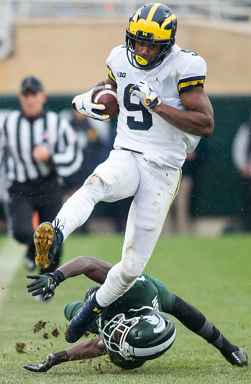 Donovan Peoples-Jones #9 of the Michigan Wolverines avoids a tackle against the Michigan State Spartans in a game at Spartan Stadium on October 20, 2018 in East Lansing, Michigan.