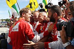 26.07.2015, Hungaroring, Budapest, HUN, FIA, Formel 1, Grand Prix von Ungarn, das Rennen, im Bild Sebastian Vettel (Scuderia Ferrari) jubelt mit seinen Mechanikern nach dem Sieg // during the race of the Hungarian Formula One Grand Prix at the Hungaroring in Budapest, Hungary on 2015/07/26. EXPA Pictures © 2015, PhotoCredit: EXPA/ Eibner-Pressefoto/ Bermel<br /> <br /> *****ATTENTION - OUT of GER*****