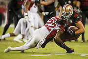 Arizona Cardinals strong safety Tony Jefferson (22) tackles San Francisco 49ers tight end Garrett Celek (88) after a pass completion at Levi's Stadium in Santa Clara, Calif., on October 6, 2016. (Stan Olszewski/Special to S.F. Examiner)