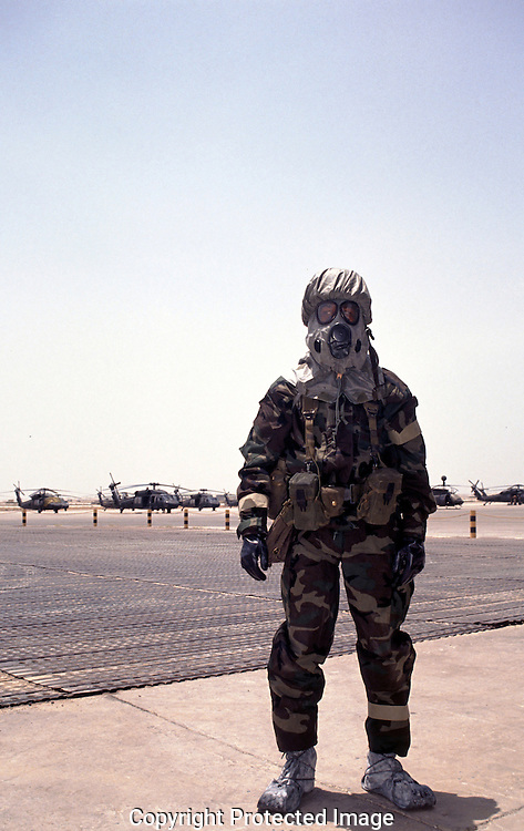 A soldier tests a chem warfare suit at an airbase in Saudi Arabis during the first days of the U.S. Troop deployment to Saudi Arabia in August 1990....Photo by Dennis Brack Bs b 16