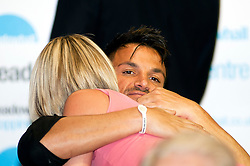 """Peter Andre hugs a fan during a book signing event to promote his new childrens books """"The Happy Birthday Party"""" and """"A New Day at School"""" in WH Smiths Sheffield on 6th September2011 Image © Paul David Drabble"""