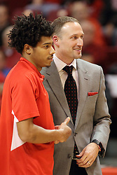 28 January 2015:   DeVaughn Akoon-Purcell and Dan Muller laugh and smile as they line up for the national anthem during an NCAA MVC (Missouri Valley Conference) men's basketball game between the Missouri State Bears and the Illinois State Redbirds at Redbird Arena in Normal Illinois