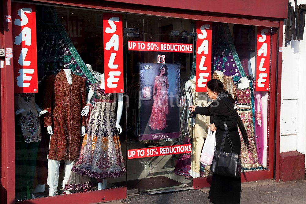 Sale at a sari shop in Southall in West London, also known as 'Little India' by some, is an area almost completely populated by people from South Asia. Figures show that the area is approximately 50 percent Indian in origin although walking the streets it would appear far higher as the local people go about their shopping in the many shops specialising in goods specific to this culture. The mix of religions is mainly Sikh, Hindu and Muslim.<br /> <br /> Southall is primarily a South Asian residential district. 1950 was when the first group of South Asians arrived in Southall, reputedly recruited to work in a local factory owned by a former British Indian Army officer. This South Asian population grew due to the closeness of expanding employment opportunities. The most significant cultural group to settle in Southall are Indian Punjabis.