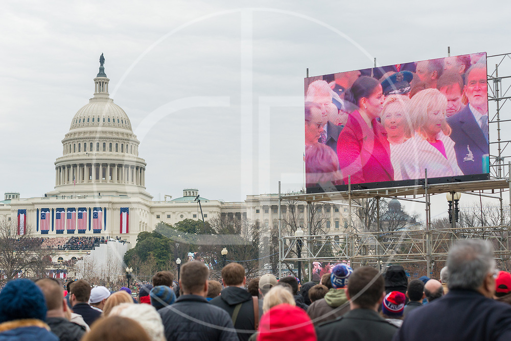 Washington DC, United States - Former Presidents, First Ladies and dignitaries are seen on a Jumbotron during the 2017 inauguration of Donald J. Trump.