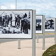 Photos on display at the Malvinas War Memorial, a large war memorial on a waterfront park in Ushuaia, Argentina, dedicated to what the 1982 conflict between Argentina and the United Kingdom, over what are known in Britain as the Falkland Islands and are known in Argentina as the Malvinas Islands.