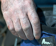 a climber's hand covered in chalk dust after working flesh for lulu (12a)