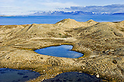 Spitsbergen, Norway - It seems an unlikely place to find such a symbol of romance. But Mother Nature chose this bleakly beautiful Arctic landscape to leave her mark in the form of a stunning heart-shaped lake. It has emerged as climate change melted the glacier that covered the area. Blocks of ice trapped during the glacier's retreat caused the ground to cave in, creating a heart-like hollow, some 120ft by 90ft, that then filled with rainwater or snow melt.  The picture was taken by French photographer Bruno Mazodier on Spitsbergen, the largest island in the Svalbard archipelago. The Norwegian island 620 miles from the North Pole is the most northerly inhabited-place on Earth, although people are outnumbered by polar bears.  Dr Bryn Hubbard, of Aberystwyth University, said: 'The glaciers all through this island chain have receded, but the heart shape is an anomaly. You would do well to find another.'<br /> ©Exclusivepix