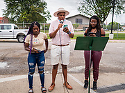 19 JUNE 2020 - DES MOINES, IOWA: Speakers at the State Fairgrounds during Juneteenth celebrations in Des Moines. The caravan drove through the Des Moines metro area. The caravan was called Ride With Us, a Driving March. Hundreds of motorists participated in the rush hour event.       PHOTO BY JACK KURTZ