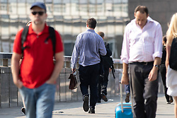 © Licensed to London News Pictures. 26/07/2018. London, UK. Commuters walk over London Bridge on what is predicted to be the hottest day of the year. Temperatures in the capital are set to rise up to 35 degrees, as the UK experiences a prolonged heatwave. Photo credit : Tom Nicholson/LNP