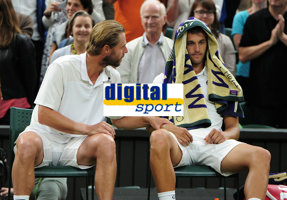 Tennis - 2017 Wimbledon Championships - Week Two, Saturday [Day Twelve]<br /> <br /> Mens Doubles Final match<br /> <br /> Lukasz Kobot (POL) and Marcelo Melo (BRA) vs. Oliver Marach  (AUT) and Mate Pavic (CRO)<br /> <br /> Dejected players, Oliver Marach and Mate Pavi seat in their seats after defeat on  Centre court <br /> <br /> COLORSPORT/ANDREW COWIE