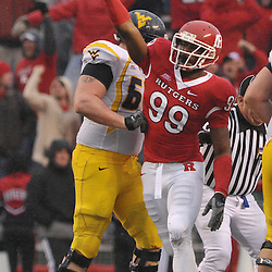 Dec 5, 2009; Piscataway, NJ, USA; Rutgers defensive end Jonathan Freeny (99) celebrates a Rutges fumble recovery during second half NCAA Big East college football action in West Virginia's 24-21 victory over Rutgers at Rutgers Stadium.