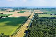 Nederland, Flevoland, Gemeente Zeewolde, 27-08-2013;<br /> Knardijk richting Zeewolde met een deel van het Knarbos in de voorgrond. De dijk vormt de grens tussen Oostelijk en Zuidelijk Flevoland en voorkomt dat bij een dijkdoorbraak de gehele Flevopolder overstroomt.<br /> Knardijk.The dike forms the border between Eastern and Southern Flevoland and prevents in case of breach of the outer dikes of the polder, that the entire Flevo polder will be flooded.<br /> luchtfoto (toeslag op standaard tarieven);<br /> aerial photo (additional fee required);<br /> copyright foto/photo Siebe Swart.