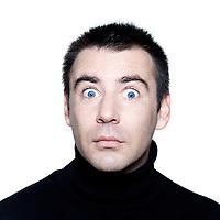 caucasian man stun surprised startle  portrait expressing portrait on studio isolated white background