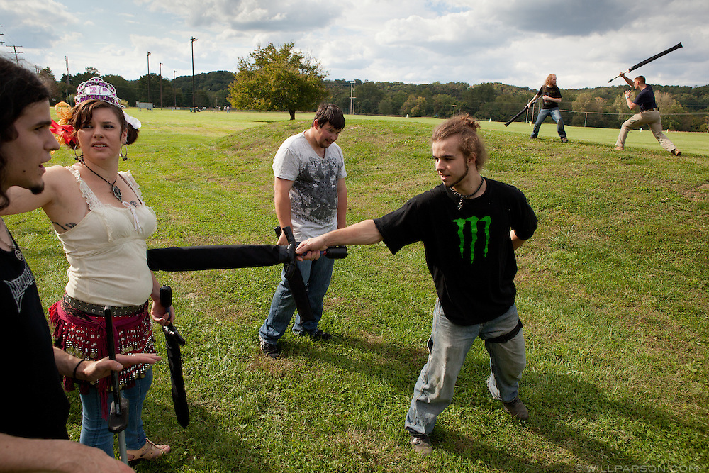 Anthony Rohn of Athens, Ohio, pokes Ravan Garland, of Athens, while she talks with Cory Medina, of Richmond, Va., Colin Zavacky, of Pittsburg, rests, and Zach Willard, of Pittsburg, spars with Paul Foreman, of Richmond, in Athens on Sept. 17, 2011.