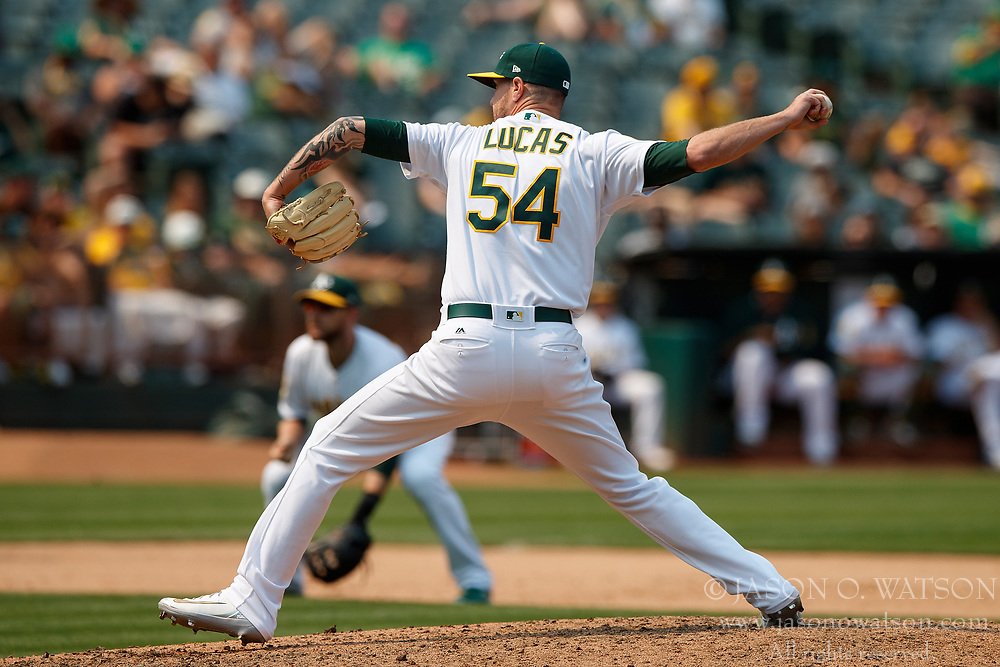 OAKLAND, CA - JULY 01: Josh Lucas #54 of the Oakland Athletics pitches against the Cleveland Indians during the eighth inning at the Oakland Coliseum on July 1, 2018 in Oakland, California. The Cleveland Indians defeated the Oakland Athletics 15-3. (Photo by Jason O. Watson/Getty Images) *** Local Caption *** Josh Lucas