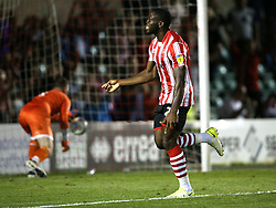 Lincoln City's John Akinde celebrates scoring his side's first goal of the game against Bury