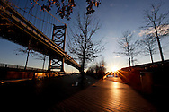 The sun rises over the Delaware River  from the Race Street Pier under the Benjamin Franklin Bridge in Philadelphia, Pennsylvania on January 18th 2012. (Photo By Brian Garfinkel)