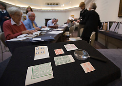 © Licensed to London News Pictures. 01/09/2011. London, UK. Part of The Philatelic Collection of Lord Steinberg estimated to fetch in the region of £4 million at a Sotheby's sale on September 6-8 2011. The collection includes a block of 9 Penny Black 1840 1d estimated to fetch £130,000 to £150,000.  Photo credit: Ben Cawthra/LNP
