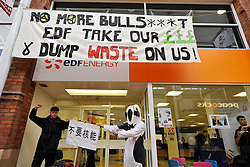 © Licensed to London News Pictures. 21/10/2013.  Bridgwater, Somerset, UK.  Anti-nuclear protesters hang a banner and dump manure at the EDF Energy shop in Angel Place shopping centre in Bridgwater.  The UK Government today announced the go-ahead for a new nuclear power station at Hinkley Point C in Somerset, to be built by a consortium with French firm EDF Energy and Chinese investment for the first time in UK nuclear power generation.  21October 2013.<br /> Photo credit : Simon Chapman/LNP