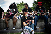 WASHINGTON, DC -- 8/28/20 -- Wesley Smith with BLMIVINC in Imperial, CA, braids his daughter's hair. Her name is Amanda Smith, 19. At left is Candi J. (Wouldn't give last name), of Charlotte, NC and at right is Marlene Thomas, of El Centro, CA<br /> The 57th Anniversary March on Washington drew thousands to the National Mall to hear activists speak at the Lincoln Memorial .…by André Chung #_AC20157