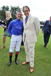 Left to right, FRANKIE DETTORI and the EARL OF MARCH at the 3rd day of the 2012 Glorious Goodwood racing festival at Goodwood Racecourse, West Sussex on 2nd August 2012.