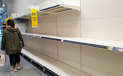 "© Licensed to London News Pictures. 24/09/2020. London, UK. A woman walks past empty shelves in Wlklo supermarket in London, as essential items start to run out, amid a possible second lockdown due to a rise in COVID-19 cases. Foreign Secretary, DOMINIC RAAB has said that, a second national lockdown could be needed if the latest coronavirus restrictions do not work but the government will ""take every effort to avoid that"". Photo credit: Dinendra Haria/LNP"