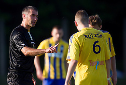 Referee Miran Bukovec and  Matic Mirtic of Dob during football match between NK Aluminij Kidricevo and NK Roltek Dob in 27th, last Round of 2nd SNL, on May 19, 2012 in Sports park Kidricevo, Slovenia. NK Aluminij defeated NK Dob 2-1, won 2nd SNL and qualified to 1st SNL. (Photo by Vid Ponikvar / Sportida.com)