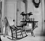 0002-B01 Pacific Argand wood stove and rocking chair inside a Portland residence. September 1906 calendar on wall.
