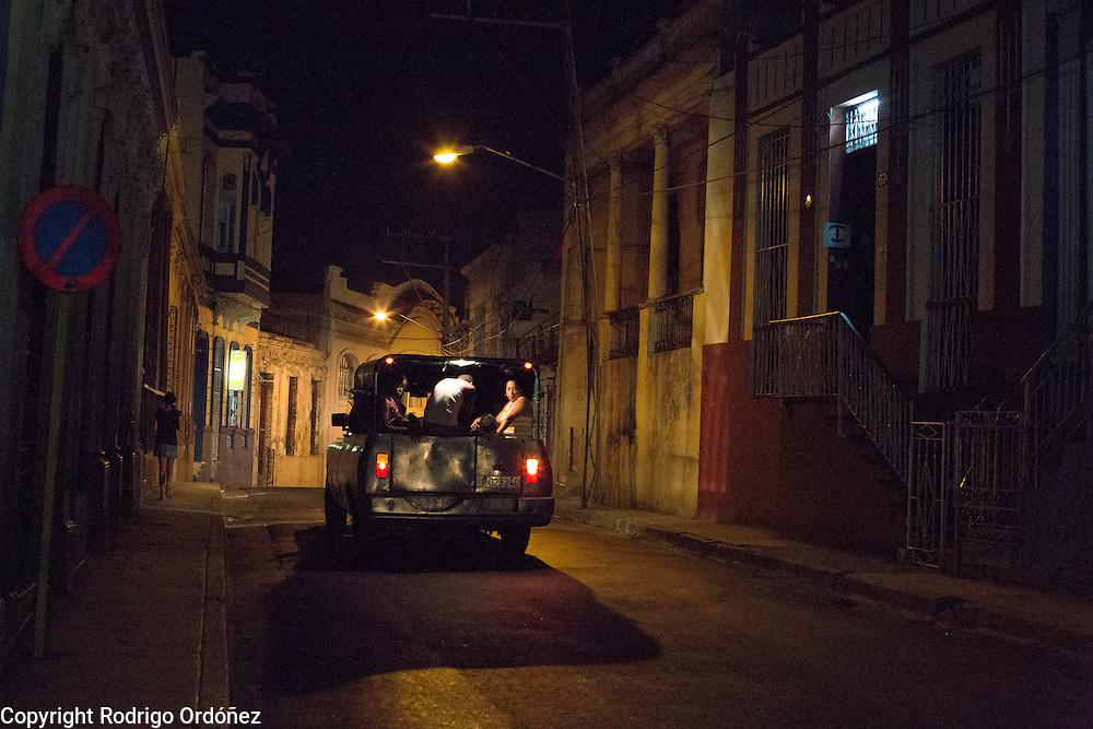 Commuters ride a collective taxi in Santiago de Cuba, Cuba, in the early evening of December 25, 2014.
