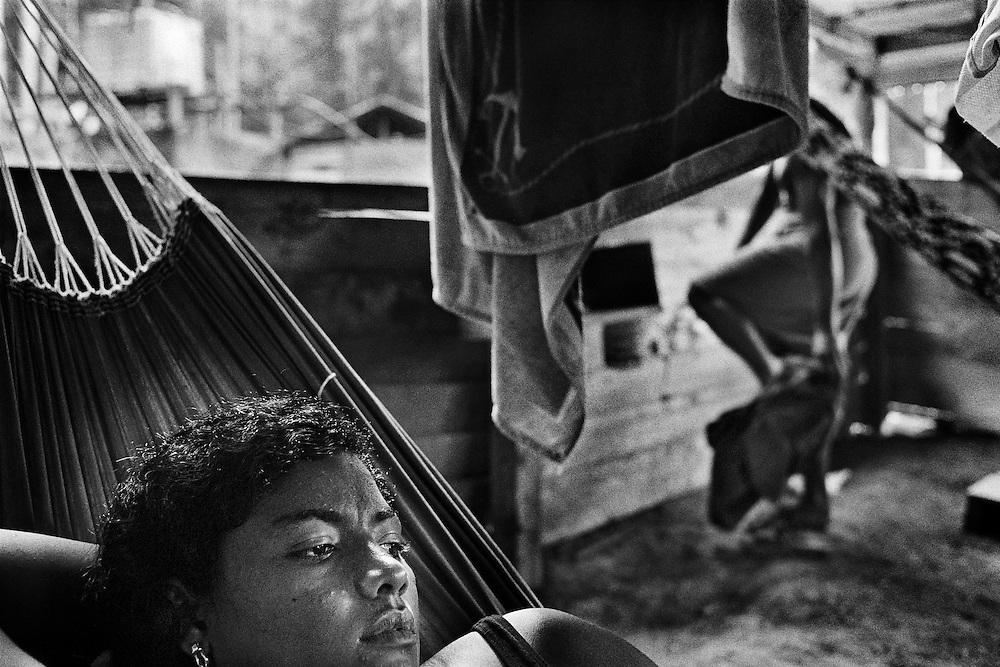 """French Guiana, Ibiza, Ipoussing.<br /> <br /> Concession miniere, """"garota de programa"""".<br /> L'economie de nombreuses colonies de l'Amazonie bresilienne dépend de l'activite aurifere et de ses métiers derives. Pendant que les hommes partent faire les garimpeiros sur les chantiers guyanais, les femmes vont faire des programmes en foret.<br /> Elles font la tournee des sites miniers pour rejoindre des clients qu'elles accompagnent quelques jours, en fonction de la production d'or."""