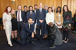 The Duke of Cambridge with runners who feature in the BBC's documentary 'Mind over Marathon' as he attends a reception and screening at Old Broadcasting House in London.