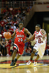 03 February 2007: Daniel Ruffin drives with Domintrix Johnson riding shotgun. In what is locally referred to as the War on Seventy Four, the Bradley Braves defeated the Illinois State University Redbirds 70-62 on Doug Collins Court inside Redbird Arena in Normal Illinois.
