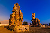 Colossus of Memnon (massive stone statues) in the Theban necropolis, near the Valley of the Kings, Egypt