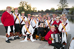 "© Licensed to London News Pictures. 01/05/2015. Stratford upon Avon, Warwickshire, UK. The Shakespeare Morris Men ""Dance in the Dawn"" in the centre of Stratford upon Avon on the first day of May. Pictured, the group pose for a photograph on the banks of the River Avon. Photo credit : Dave Warren/LNP"
