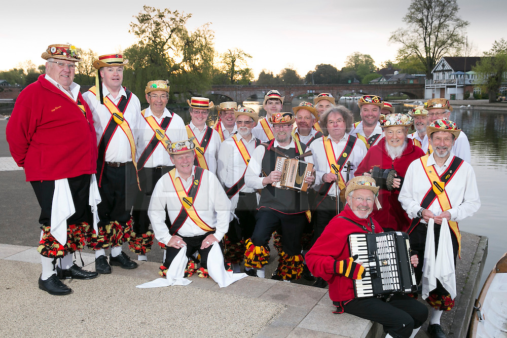 """© Licensed to London News Pictures. 01/05/2015. Stratford upon Avon, Warwickshire, UK. The Shakespeare Morris Men """"Dance in the Dawn"""" in the centre of Stratford upon Avon on the first day of May. Pictured, the group pose for a photograph on the banks of the River Avon. Photo credit : Dave Warren/LNP"""