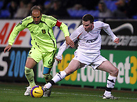 Photo: Paul Thomas/Sportsbeat Images.<br /> Bolton Wanderers v Aris Salonica. UEFA Cup. 29/11/2007.<br /> <br /> Danny Guthrie (R) of Bolton battles with Konstantinos Nempegleras.